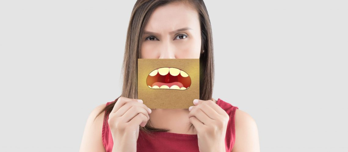 Gurinsky DDS - Woman with bad breath sign
